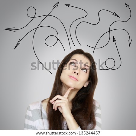 Woman thinking with many arrows above the head on grey background