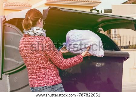 Woman throw away bag Stockfoto ©