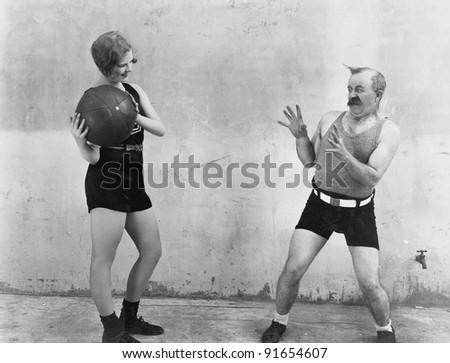 Woman throwing ball to nervous man