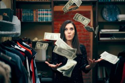 Woman Throwing with Money in Clothing Store in Sale Season. Big spender wasting her savings  on Black Friday sales