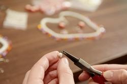Woman tinkering self made jewellery