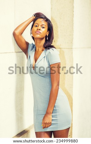 stock-photo-woman-tired-and-thinking-wearing-a-gray-business-dress-a-young-beautiful-black-woman-is-standing-234999880.jpg