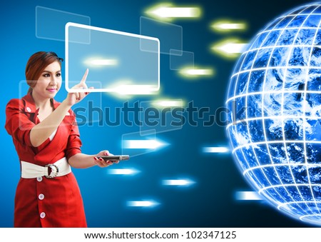 Woman touch windows icon from digital world : Elements of this image furnished by NASA