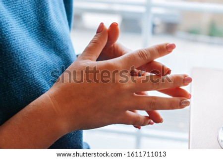 Woman touches hands while talking