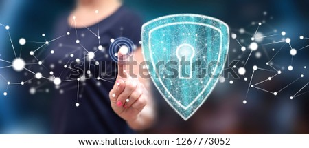 Woman touching a digital security concept on a touch screen with her finger