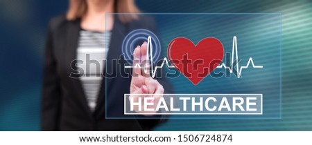 Woman touching a healthcare concept on a touch screen with her fingers