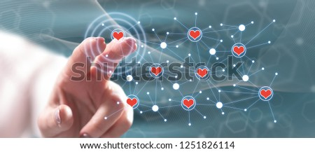 Woman touching a virtual social network on a touch screen with her finger #1251826114