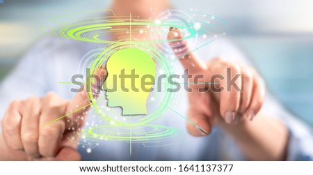 Woman touching an artificial intelligence concept on a touch screen with her fingers