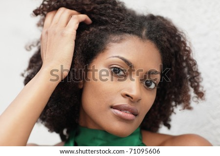 Woman touching her head