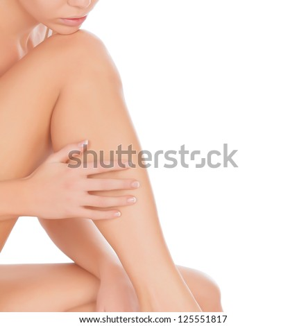 Woman touching her leg, isolated on white