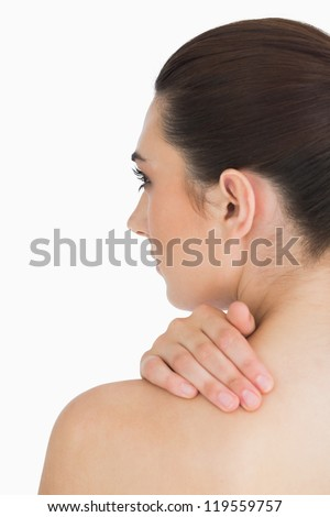 Woman touching her skin while looking away