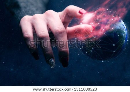 Woman touching planet with finger and network web and burn nebula dust. Mixed media.