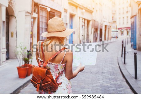 woman tourist looking at the map on the street of european city, travel to Europe Photo stock ©