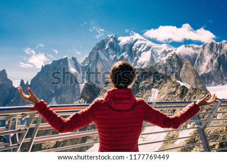 woman, tourist on the terrace Punta Helbronner in Courmayeur Italy , over mountain Montblanc