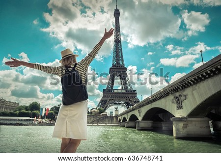 Woman tourist selfie near the Eiffel tower in Paris under sunlight and blue sky. Famous popular touristic place in the world. #636748741