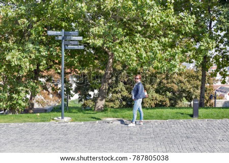 Woman tourist stands close to touristic sights info pointer in Bratislava Castle, Slovakia. #787805038