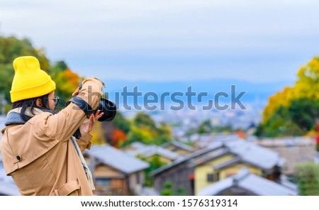 woman tourist traveler enjoy taking photo of the scenery Autumn view beside the road at Countryside, traveling in Countryside of Japan prefecture