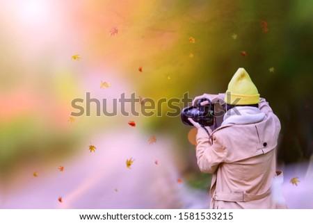 woman tourist traveler, Photographer enjoy taking photo of the scenery Autumn view beside the road at Countryside, traveling in Countryside of Japan prefecture