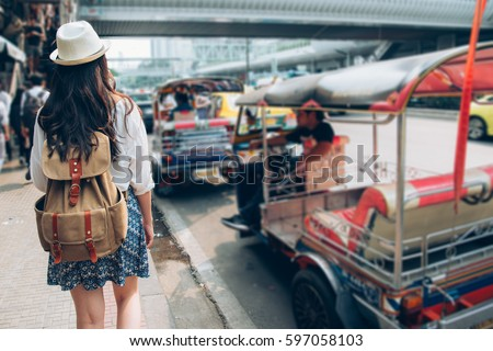 woman tourist walking in busy...