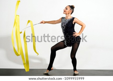 Woman train acrobatics with ribbon. Fitness and dieting of girl gymnast. Woman with ribbon for rhythmic gymnastic. Workout sports activities in gym of flexible girl. Sport success and health.