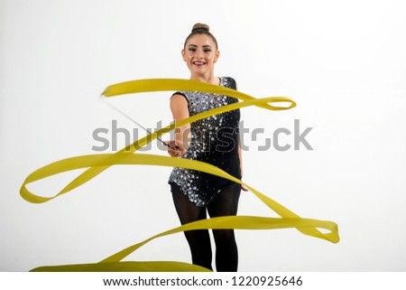 Woman train acrobatics with ribbon. Sport success and health. Workout sports activities in gym of flexible girl. Fitness and dieting of girl gymnast. Woman with ribbon for rhythmic gymnastic.