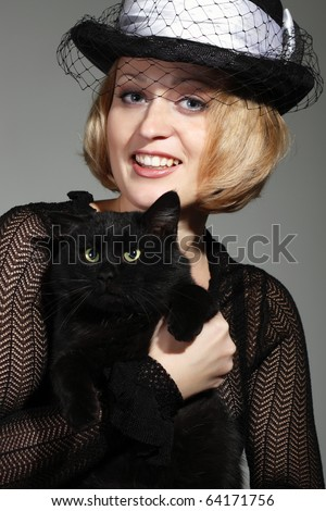 woman trainer with black cat