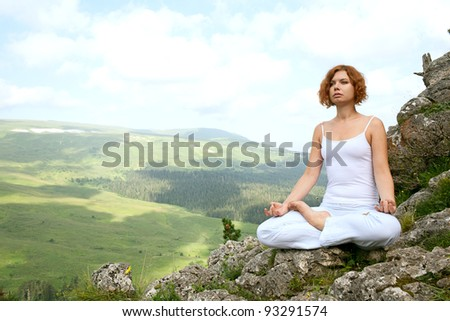 woman training yoga on beauty landscape
