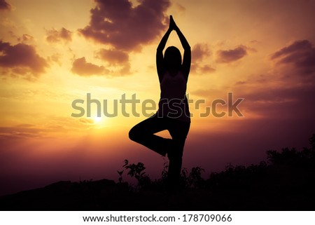 Woman training yoga on the mountain at sunset #178709066