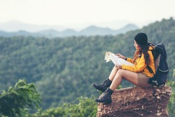 Woman travel hiker adventure on mountain nature landscape. Asia people lifestyle tourist girl backpack sitting with map to find directions explore and camping outdoors for relax summer time.