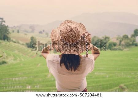 woman traveler looking at green ...