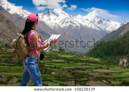 Woman traveler looks into the distance