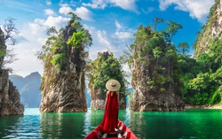 Woman traveler on boat joy nature view rock island scenic landscape Khao Sok National Park, Famous attraction adventure place travel Thailand, Tourism beautiful destinations Asia holiday vacation trip