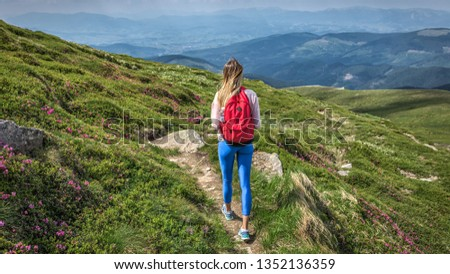 Woman traveler outdoor with backpack walks outside  trip in mountains summer hike ascent