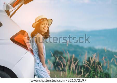 woman traveler sitting on...