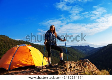 woman traveler with a big backpack and tent in the mountains #1482154574