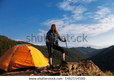 woman traveler with a big backpack and tent in the mountains #1482154580