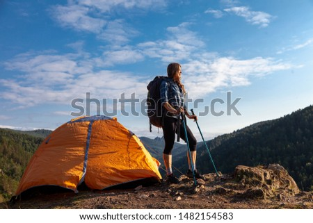 woman traveler with a big backpack and tent in the mountains #1482154583