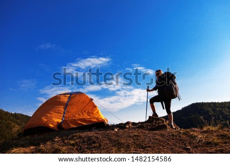 woman traveler with a big backpack and tent in the mountains #1482154586