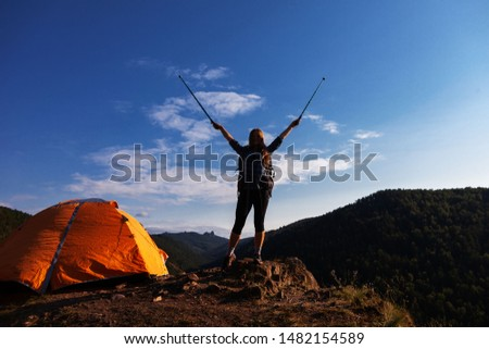 woman traveler with a big backpack and tent in the mountains #1482154589