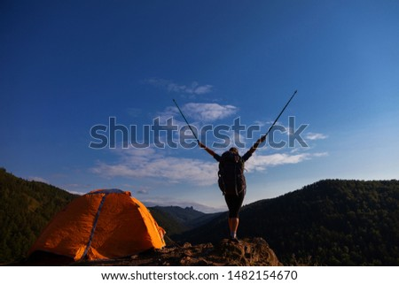 woman traveler with a big backpack and tent in the mountains #1482154670
