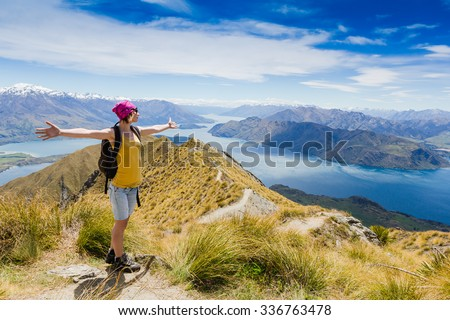 Woman Traveler with Backpack hiking in Mountains. New Zealand. Lake wanaka and Mt Aspiring