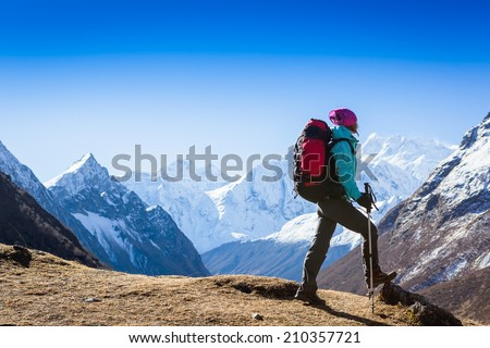 Woman Traveler with Backpack hiking in Mountains with beautiful summer landscape on background. mountaineering sport lifestyle concept  #210357721