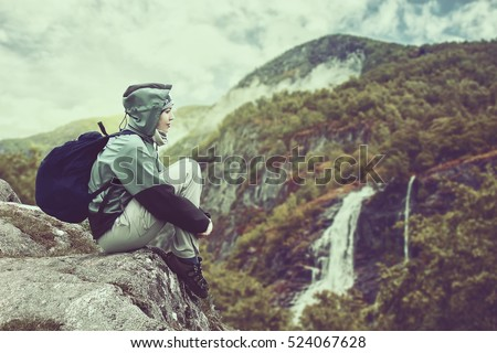 woman traveler with backpack...