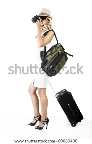 woman traveling and taking pictures with her camera