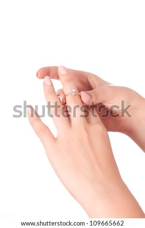 woman tries on a gold ring with diamonds isolated on white background - stock photo