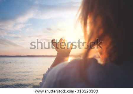 woman try to grab the sun