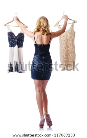 Woman trying new dresses on white