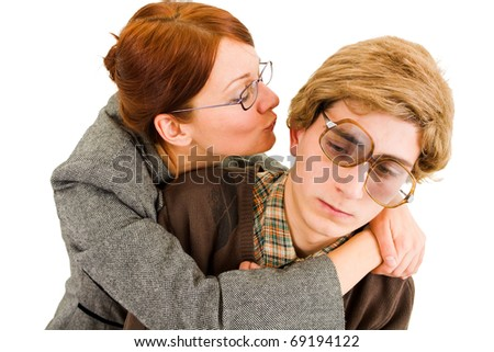 woman trying to kiss a nerd