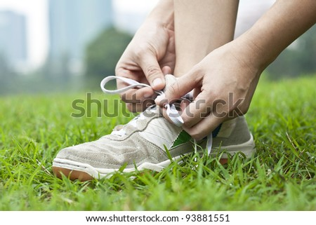 Woman tying sports shoe