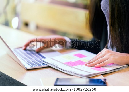Woman typing computer keyboard to book calendar schedule in laptop, timetable reservation for business appointment. Planner organizer using to manage a busy checklist agenda with memo reminder